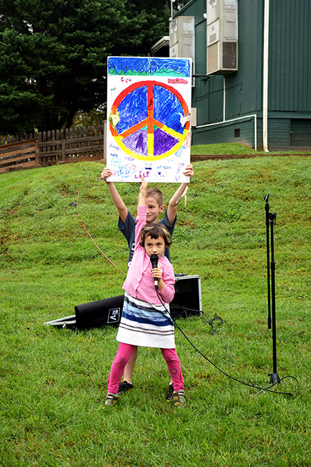 a child displays her peace day poster