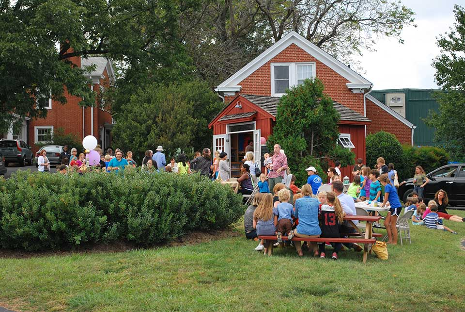 families gather for the opening of a middle school business